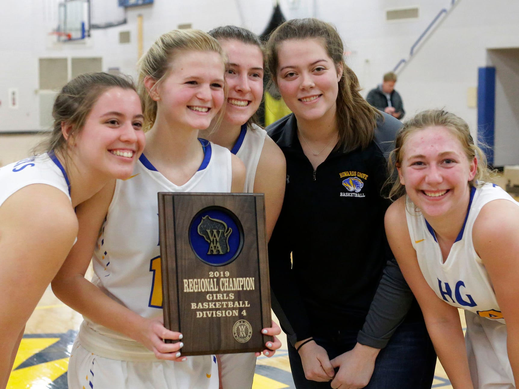 Howards Grove players pose with the WIAA Division 4 regional trophy, Saturday, February 23, 2019, at Howards Grove, Wis.