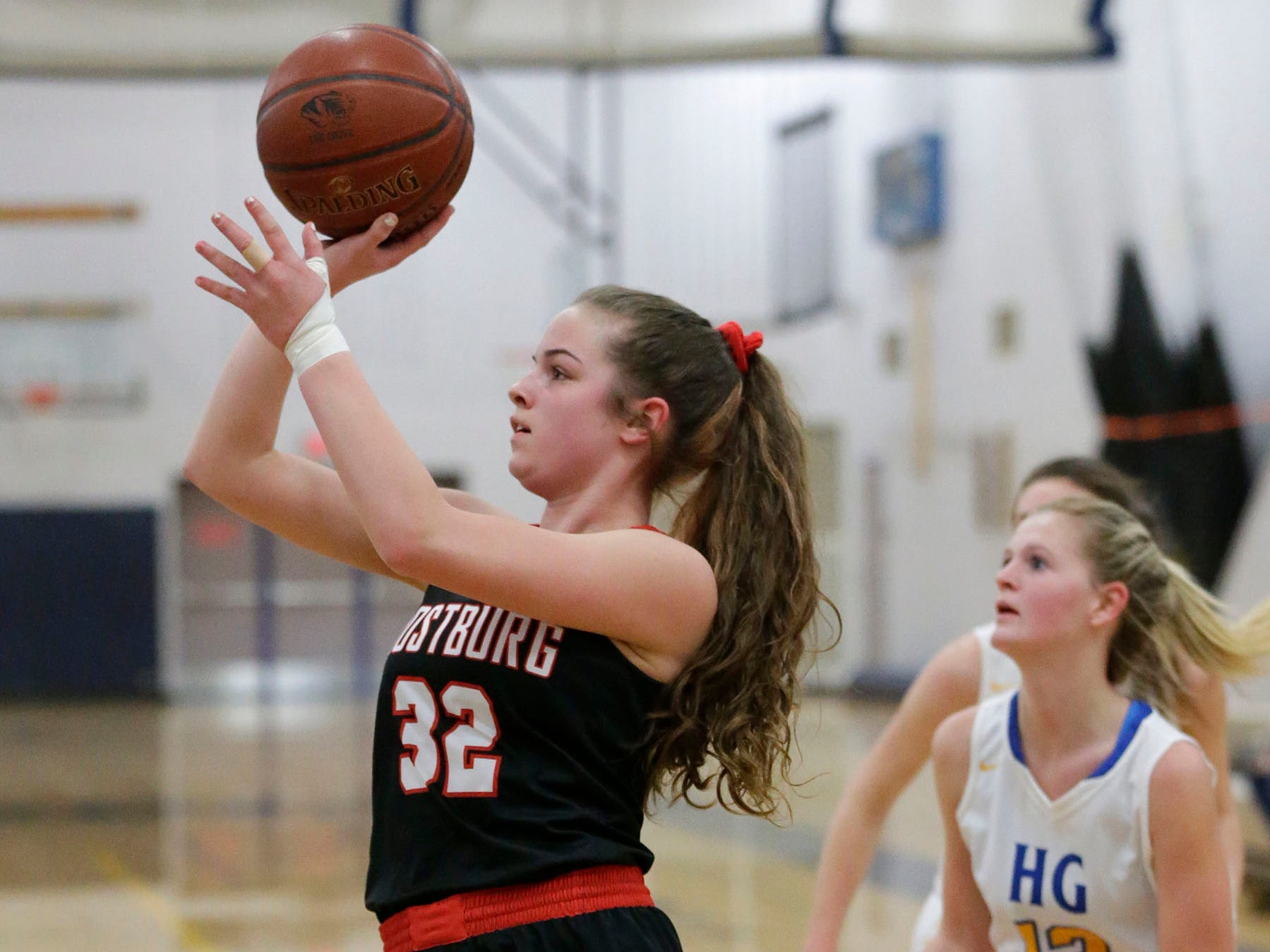 Oostburg's Cambell Van Ess (32) launches a shot against Howards Grove, Saturday, February 23, 2019, at Howards Grove, Wis.