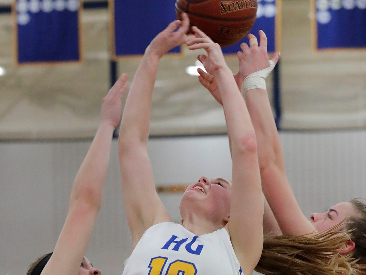 Howards Grove's Leah Parnitzke (10) works to rebound the ball against Oostburg, Saturday, February 23, 2019, at Howards Grove, Wis.