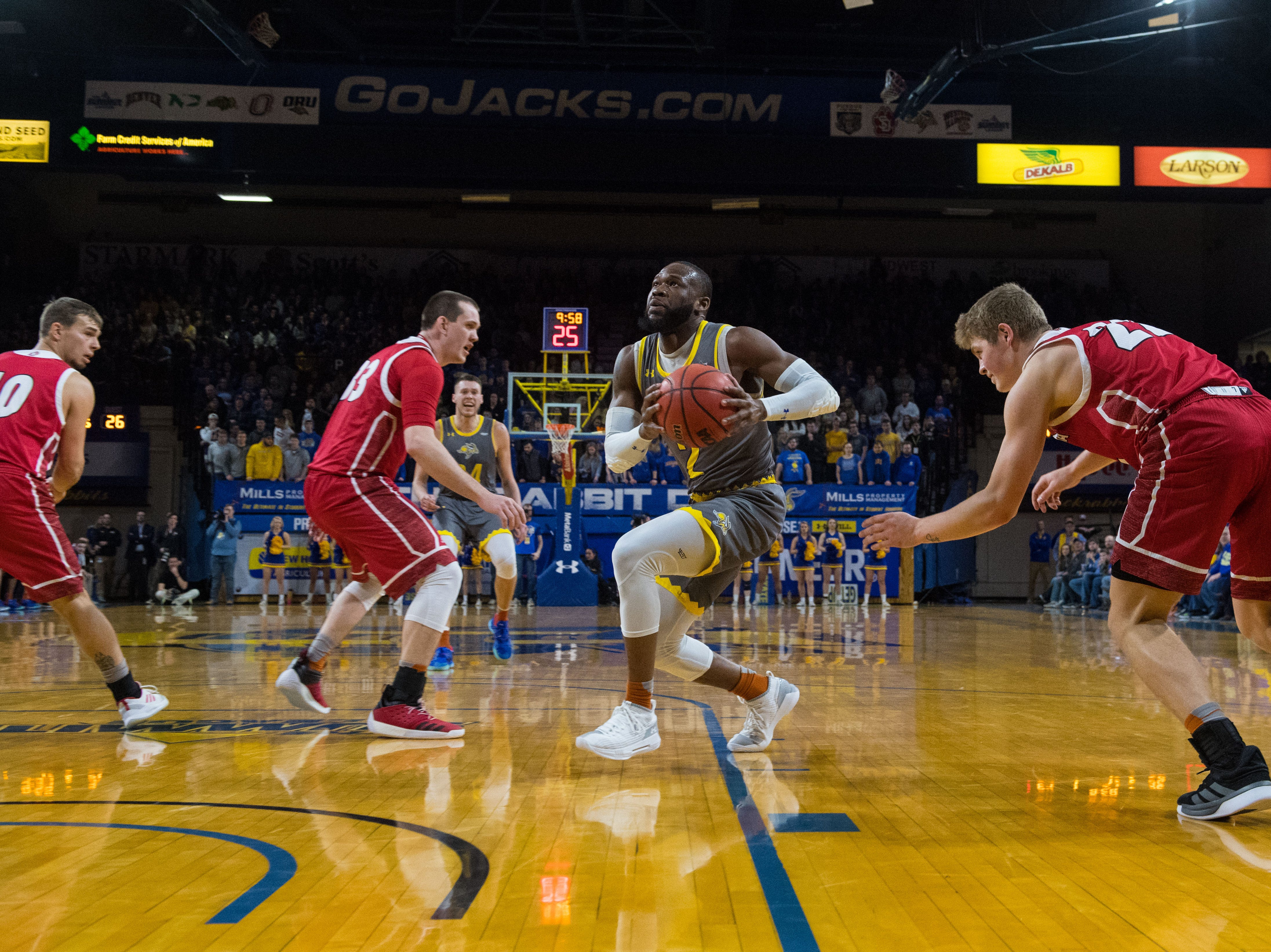 SDSU's Tevin King (2) dribbles the ball past USD players during a game, Saturday, Feb. 23, 2019 in Brookings, S.D.