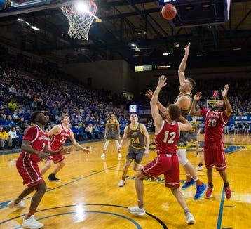 SDSU's Mike Daum (24) reaches his 3,000 career points during the game against USD, Feb. 23, 2019 in Brookings, S.D.
