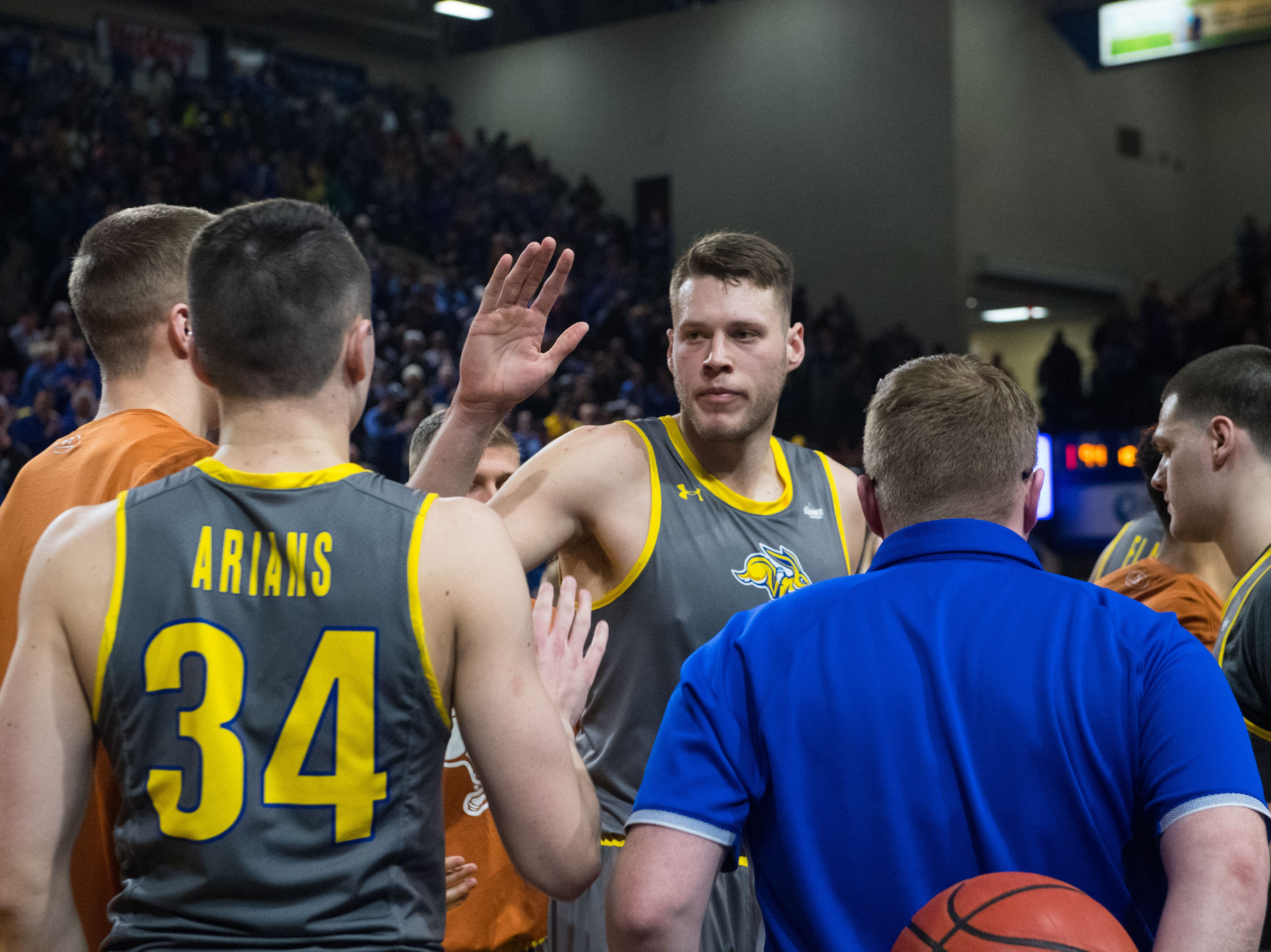 SDSU's Mike Daum (24) celebrates after the game against USD, Saturday, Feb. 23, 2019 in Brookings, S.D.