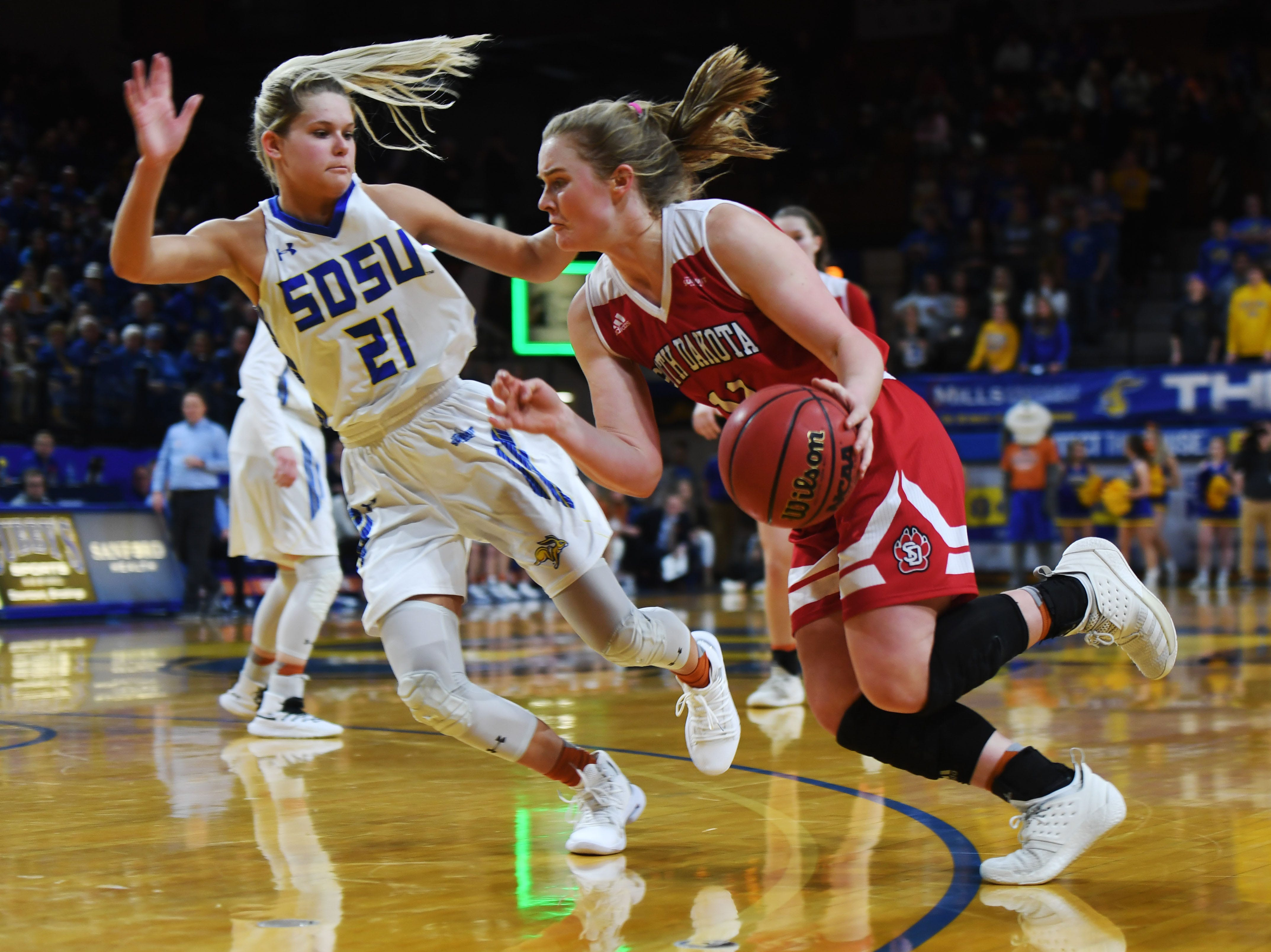 USD's Monica Arens goes against SDSU's Tylee Irwin during the game Sunday, Feb. 24, at Frost Arena in Brookings.