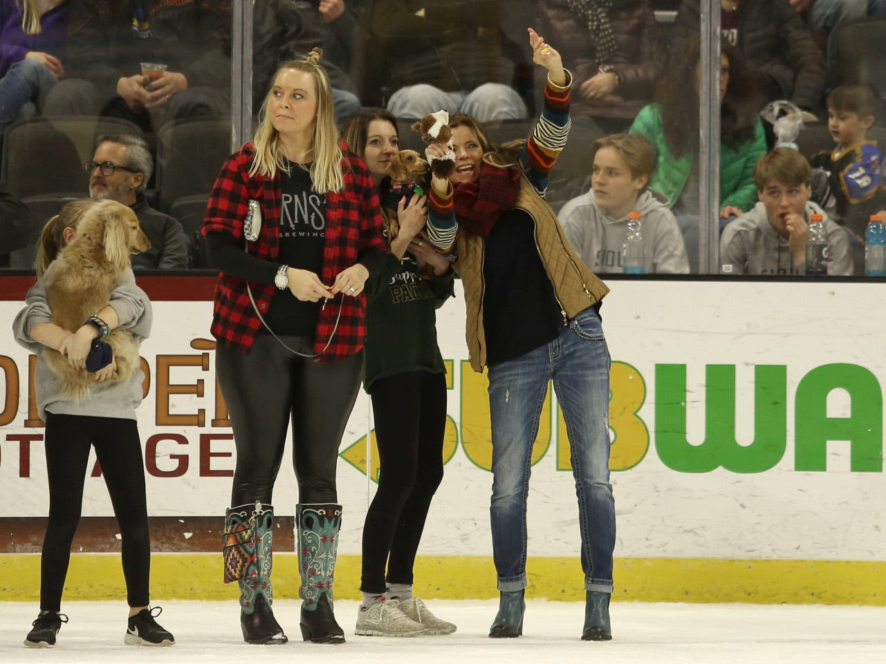Competitors wave to their supporters before starting a  heat race Saturday of the 12th annual Wiener Dog Races, Feb 23, 2019. The races took place in front of a sold out crowd during intermission as the Stampede took on the Omaha Lancers at the Denny Sanford Premier Center.
