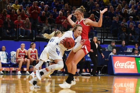 SDSU's Madison Guebert goes against USD defense during the game Sunday, Feb. 24, at Frost Arena in Brookings.