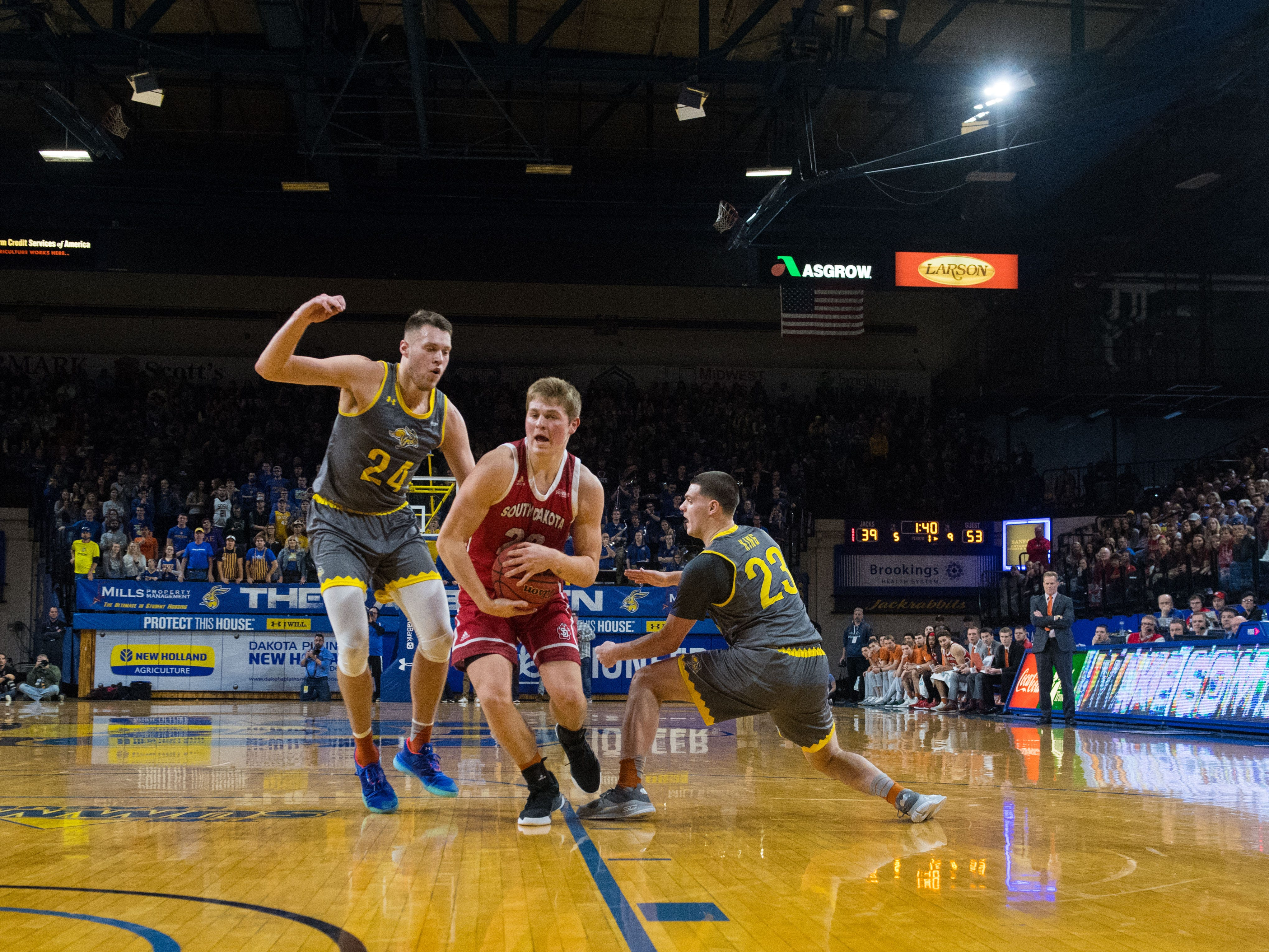 SDSU's players block USD's Tyler Peterson (22) during a game, Saturday, Feb. 23, 2019 in Brookings, S.D.