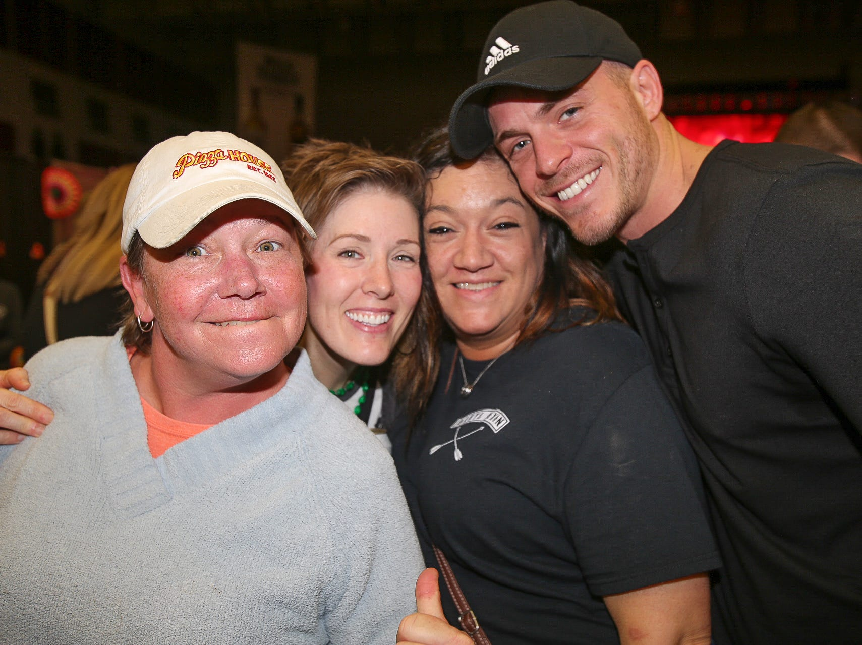 Stacy Schnieder, Michelle and Tara Eiken, and Eric Wadkins