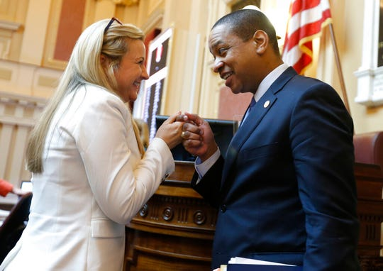 "Virginia Lt. Gov Justin Fairfax, right, says goodbye to State Sen. Amanda Chase, R-Chesterfield, he exits the floor after the Senate adjourned their 2019 session at the Capitol in Richmond, Va., Sunday, Feb. 24, 2019. Fairfax delivered an impassioned speech and said ""If we go backwards and we rush to judgment and we allow for political lynchings without any due process, any facts, any evidence being heard, then I think we do a disservice to this very body in which we all serve."" (AP Photo/Steve Helber)"