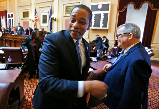 "Virginia Lt. Gov Justin Fairfax shakes the hand of State Sen. Adam Ebbin, D-Alexandria, right, as he exits the floor after the Senate adjourned their 2019 session at the Capitol in Richmond, Va., Sunday, Feb. 24, 2019. Fairfax delivered an impassioned speech and said ""If we go backwards and we rush to judgment and we allow for political lynchings without any due process, any facts, any evidence being heard, then I think we do a disservice to this very body in which we all serve."""