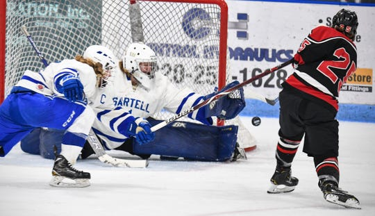 Sartell goaltender Cole Bright makes a save during the first period of the Section 6A semifinal game against Alexandria Saturday, Feb. 23, at the MAC in St. Cloud.