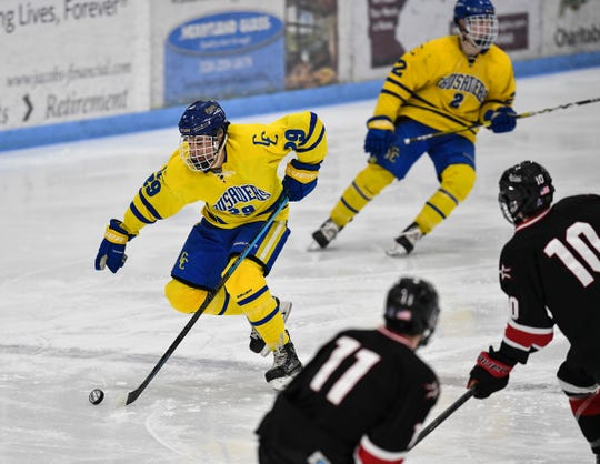 Cathedral's Jackson Savoie breaks away with the puck during the first period of the Section 6A semifinal game Saturday, Feb. 23, at the MAC in St. Cloud.