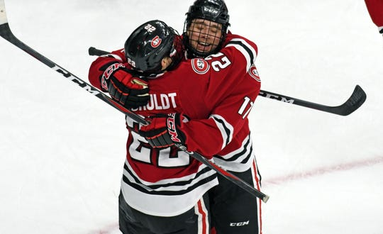 Seniors Jimmy Schuldt and Jacob Benson celebrate a St. Cloud State goal against Nebraska-Omaha at Baxter Arena on Saturday.