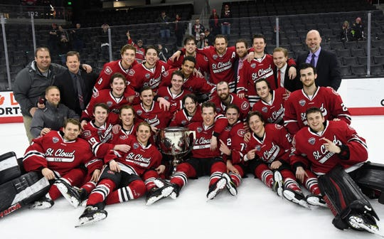 The St. Cloud State men's hockey team celebrate after shutting out Nebraska-Omaha to clinch the NCHC title.