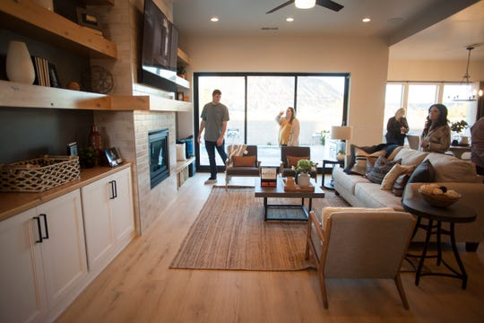 Home shoppers tour a home in St. George during the 2019 Parade of Homes on Saturday, Feb. 23, 2019. Low interest rates and population growth have helped fuel another year of fast-paced construction growth in St. George, with 2,388 building permits for residential homes in the city in 2019, a slight decline compared to 2,460 in 2018 and up from 2,212 in 2017.