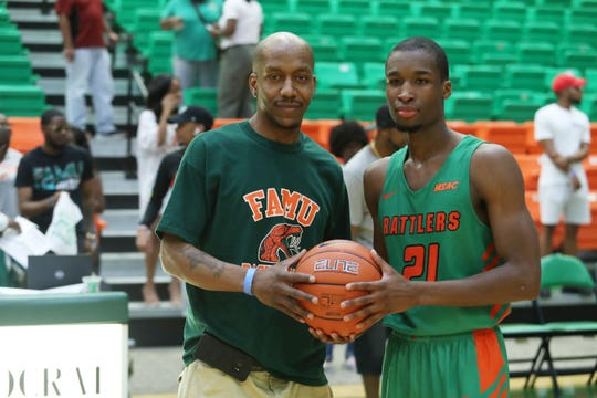 Former FAMU star Terrance Woods presented Justin Ravenel with an autographed basketball for passing his school record for career 3-point field goals.