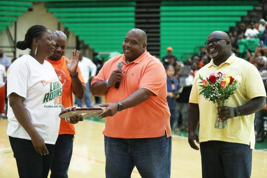 City of Gretna mayor Anthony Baker gives key to city to former FAMU star Cathy Robinson following her jersey retirement on Saturday, Feb. 23, 2019 at the Al Lawson Multipurpose Center.