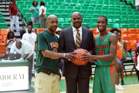 Terrance Woods (left) poses FAMU men's head coach Robert McCullum and Justin Ravenel. Woods autographed the ball Ravenel shot to break the school's career 3-point record.