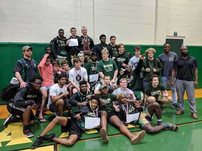 Lincoln's wrestling team won its 10th straight district title on Friday while sending all 14 wrestlers through to the region tournament.