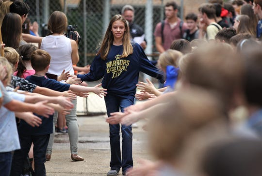 Sammi Drawdy and Aucilla Christian's girls basketball team get a send-off from their student body after qualifying for the Class 2A state tournament in Lakeland.