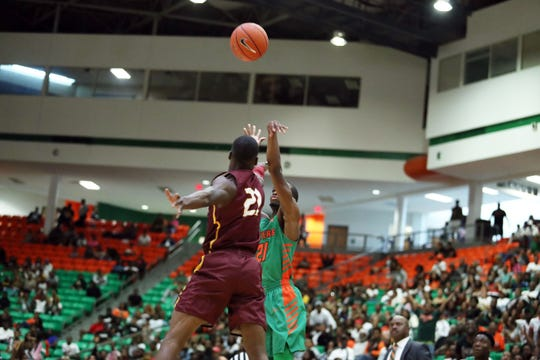 FAMU guard Justin Ravenel hits the school's record-breaking career 3-point shot over Dondre Duffas of Bethune-Cookman on Saturday, Feb. 24, 2019 at the Al Lawson Center.