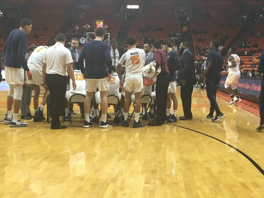 UTEP huddles during a timeout against Rice Saturday night at the Don Haskins Center