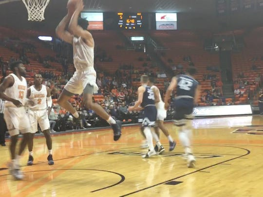 UTEP's Paul Thomas grabs a rebound against Rice Saturday night at the Don Haskins Center