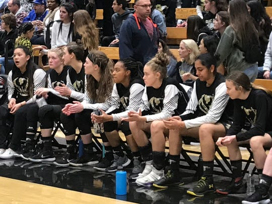 The Oak Park bench watches the final seconds of the CIF-Southern Section Division 4-AA championship game against Covina-Northview on Saturday night at Azusa Pacifica. Northview won, 47-43.