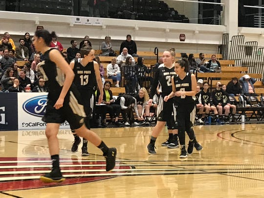 Oak Park starters Rhea Bhutada, Mia Foresti, Lynsay Garrett and Abigail Messe take the court against Covina-Northview on Saturday night in the CIF-Southern Section Division 4-AA championship game at Azusa Pacifica. Northview won, 47-43.