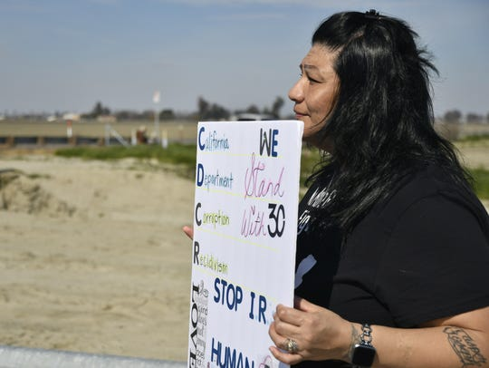 Ruby Gradillas protests outside of California State Prison-Corcoran on Saturday, Feb. 23, 2019. She wants visitation rights restored to her husband.
