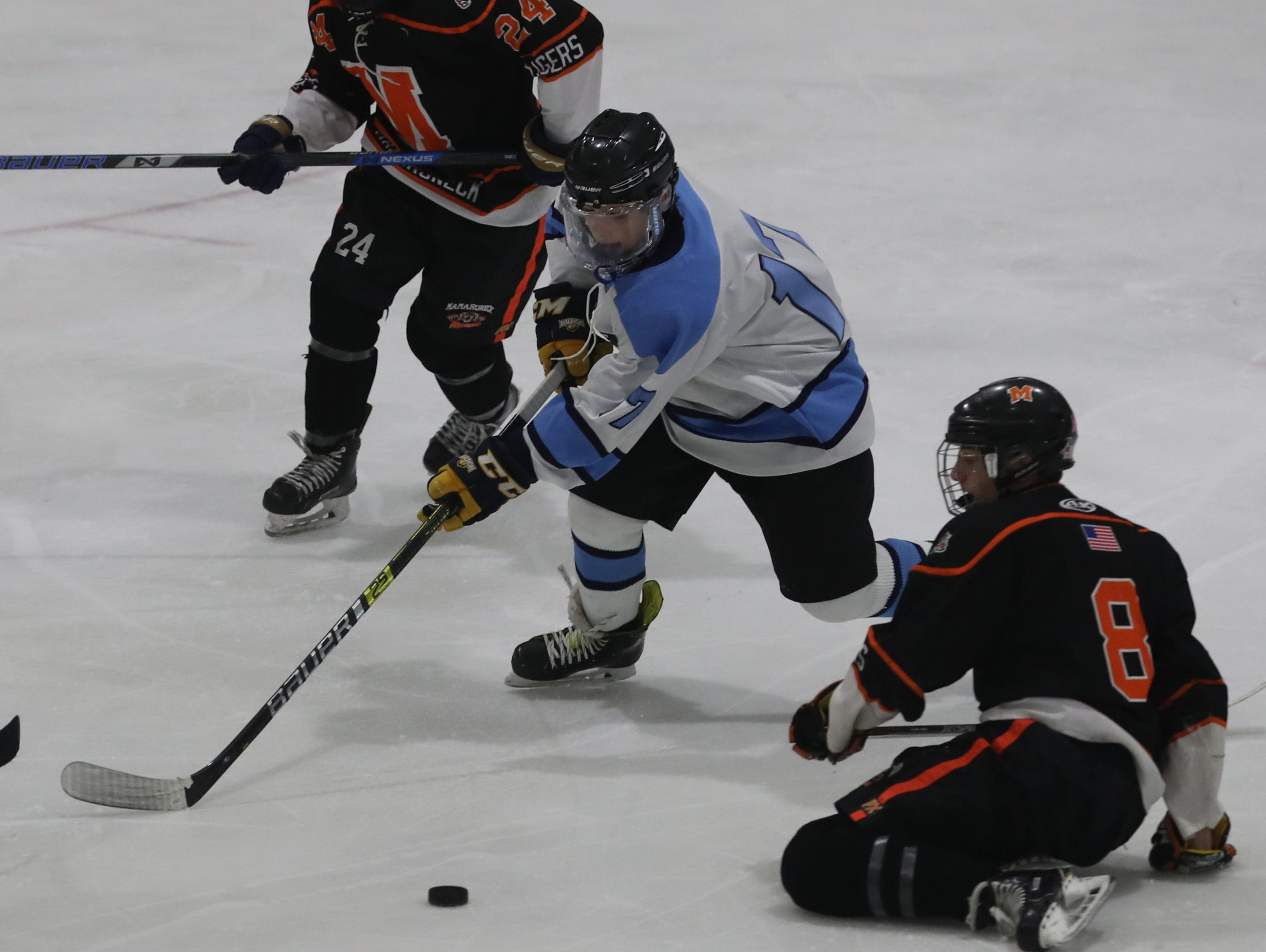 Suffern's Ben Burns battles Mamaroneck's Charile Mollin during the Section 1 Division 1 championship game at Sport-o-Rama in Monsey Feb. 24, 2019. Suffern defeated Mamaroneck 4-1.