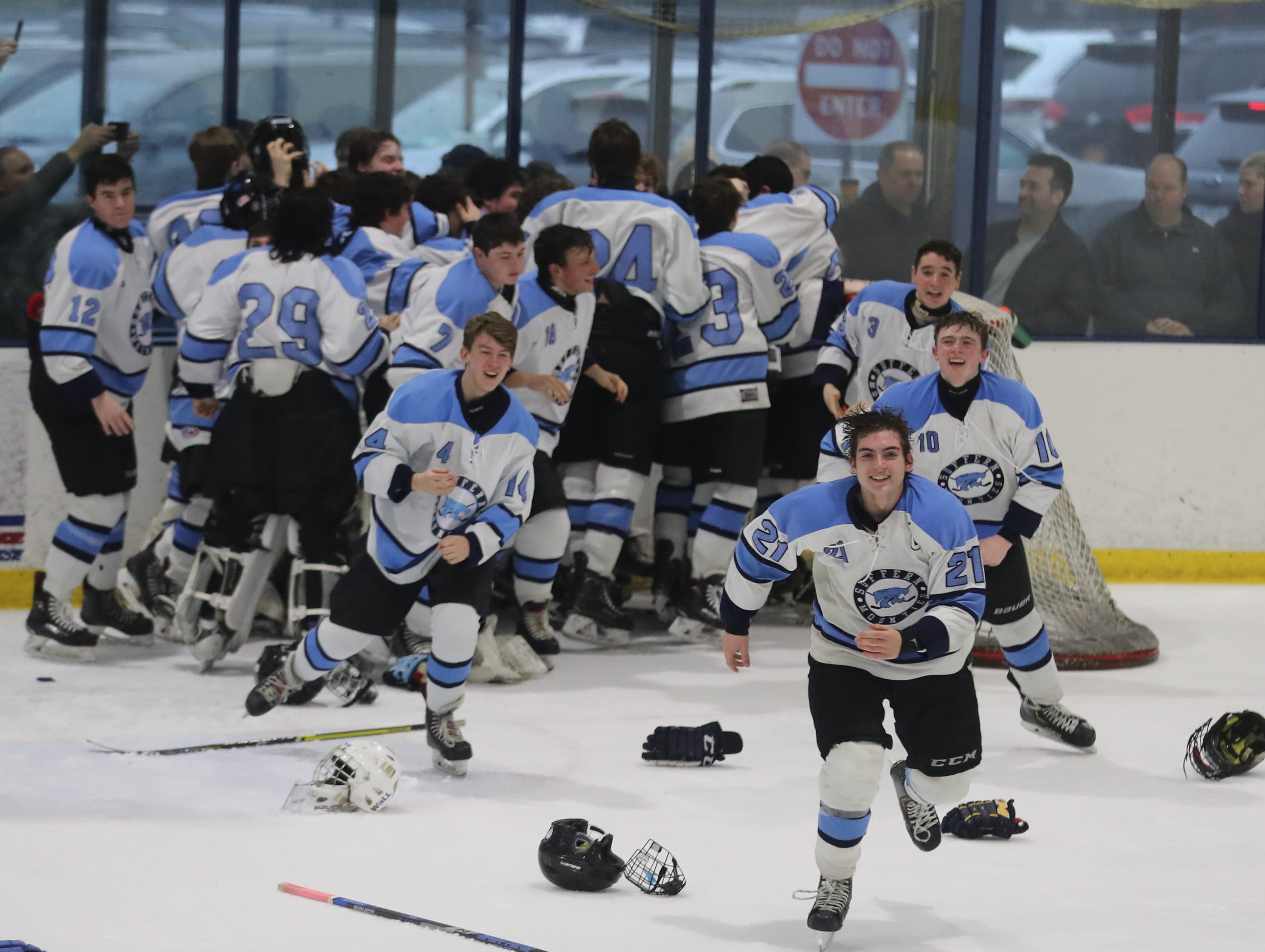 Suffern celebrates after defeating Mamaroneck 4-1 in the Section 1 Division 1 championship game at Sport-o-Rama in Monsey Feb. 24, 2019.