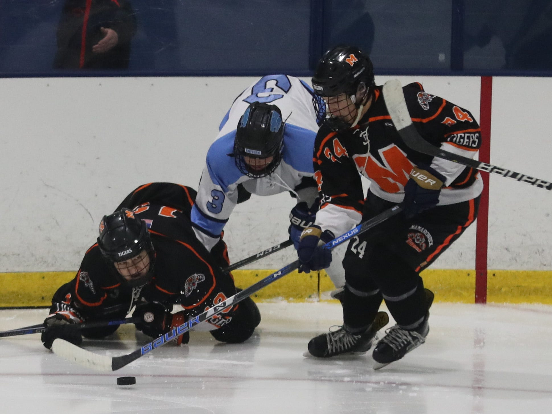 Suffern's Jared Marder goes airborne while being sandwiched against Mamaroneck during the Section 1 Division 1 championship game at Sport-o-Rama in Monsey Feb. 24, 2019. Suffern defeated Mamaroneck 4-1.