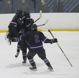John Jay Cross River celebrates their first goal against Pelham during the Section 1 Division II championship hockey game at Sport-o-Rama in Monsey Feb. 24, 2019.