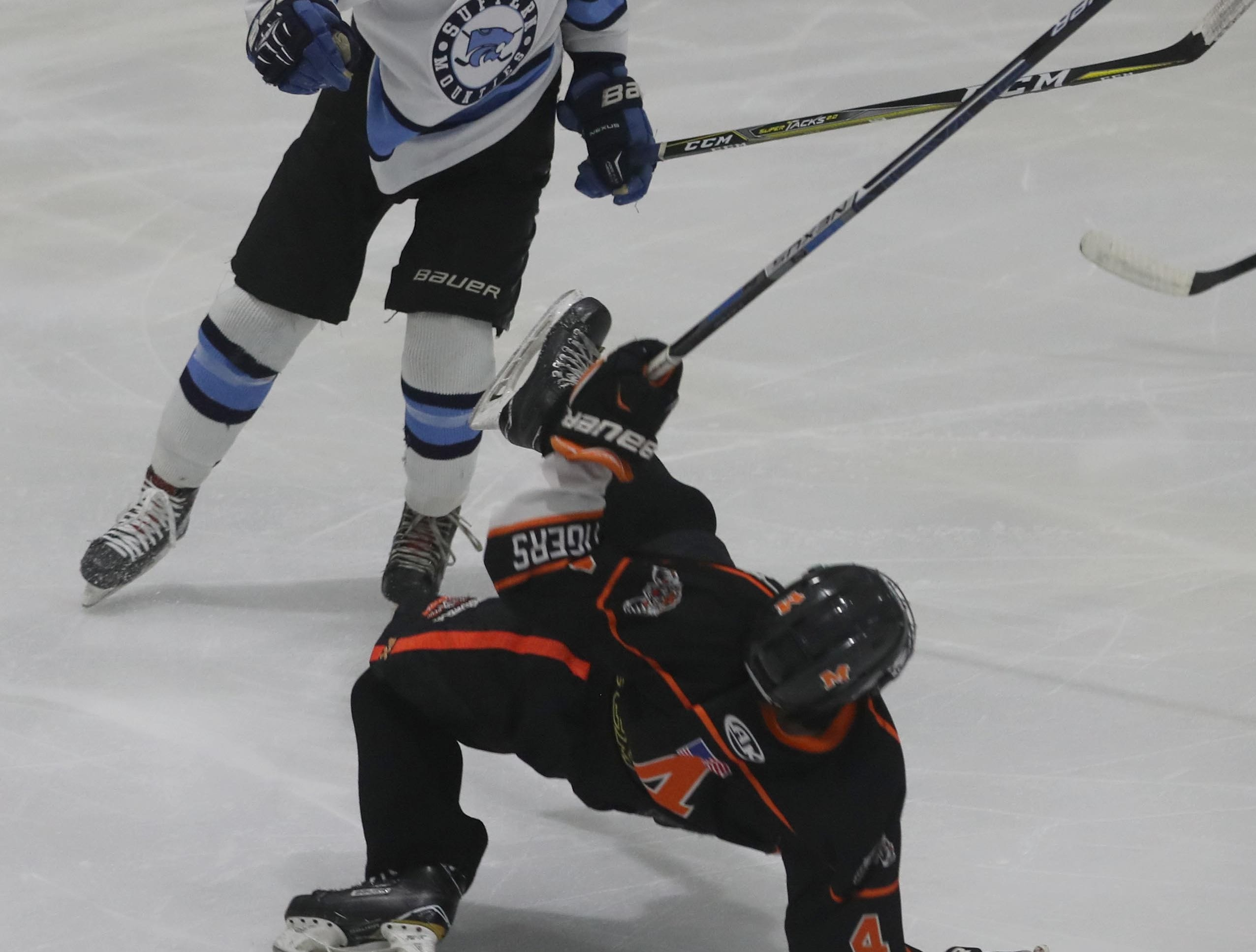 Mamaroneck's Tommy Conley goes down after a hit by Suffern's CJ Olsen during the Section 1 Division 1 championship game at Sport-o-Rama in Monsey Feb. 24, 2019. Suffern defeated Mamaroneck 4-1.Suffern defeated Mamaroneck 4-1.