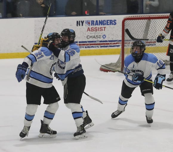 Suffern's Kyle Foresta and Ryan Shelling celebrate Foresta's second period goal against Mamaroneck during the Section 1 Division 1 championship game at Sport-o-Rama in Monsey Feb. 24, 2019. Suffern defeated Mamaroneck 4-1.