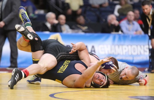 New Rochelle's Jake Logan wrestles Angelo Petrakis from Massapequa in the 182-pound final match of the NYSPHSAA championships at the The Times Union Center in Albany on Saturday, February 23, 2019.