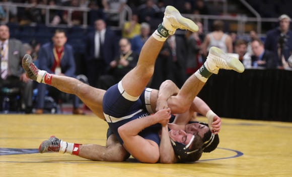 Horace Greeley's Aaron Wolk wrestles Joe Gannone of Eastport-South Manor in the 170-pound final match of the NYSPHSAA championships at the The Times Union Center in Albany on Saturday, February 23, 2019.