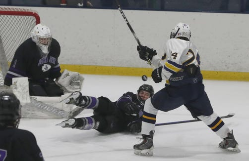 Charlie Oestreicher of John Jay Cross River gets in front of a shot by Henry Smith of Pelham during the Section 1 Division II championship hockey game at Sport-o-Rama in Monsey Feb. 24, 2019.