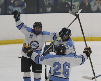 Suffern's Tom McCarren and Ryan Shelling celebrate Foresta's second period goal against Mamaroneck during the Section 1 Division 1 championship game at Sport-o-Rama in Monsey Feb. 24, 2019. Suffern defeated Mamaroneck 4-1.