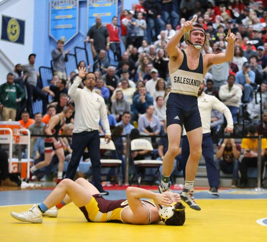 Salesianum's Zach Spence (right) reacts after his win in the championship bout at 113 pounds against Milford's Jack Thode during the DIAA state individual wrestling championships Saturday at Cape Henlopen High School.