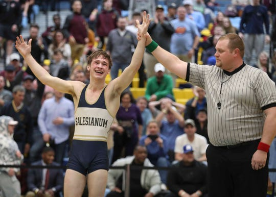Salesianum's Harry Latch reacts after winning the state title at 138 pounds with a win against Smyrna's Nicholas Natarcola during the DIAA state individual wrestling championships Saturday at Cape Henlopen High School. Latch was named tournament outstanding wrestler.