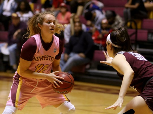Midwestern State's Liz Cathcart is gaurded by Texas Woman's Kam Daily Saturday, Feb. 23, 2019, in D.L. Ligon Coliseum at MSU Texas.