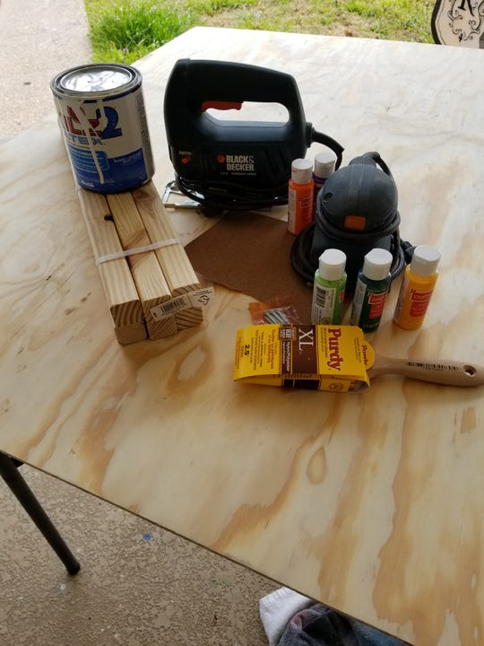 Materials needed to make an outdoor Easter decoration include: Plywood or other thin wood; hand-held jigsaw with a scroll blade attached; electric sander or sandpaper; wooden stakes; and screws and screwdriver.
