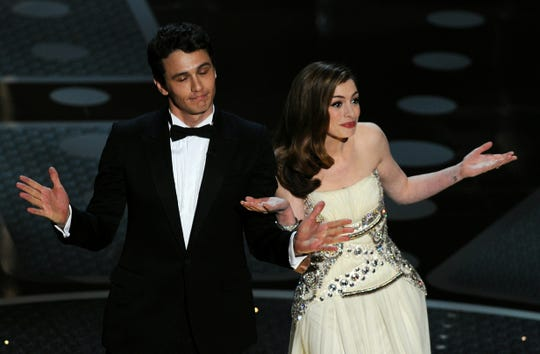 ORG XMIT: 108714015 Actor James Franco and actress Anne Hathaway introduce veteran actor Kirk Douglas on stage at the 83rd Annual Academy Awards held at the Kodak Theatre on February 27, 2011 in Hollywood, California. AFP PHOTO / GABRIEL BOUYS (Photo credit should read GABRIEL BOUYS/AFP/Getty Images) ORIG FILE ID: US-OSCARS-SHOW