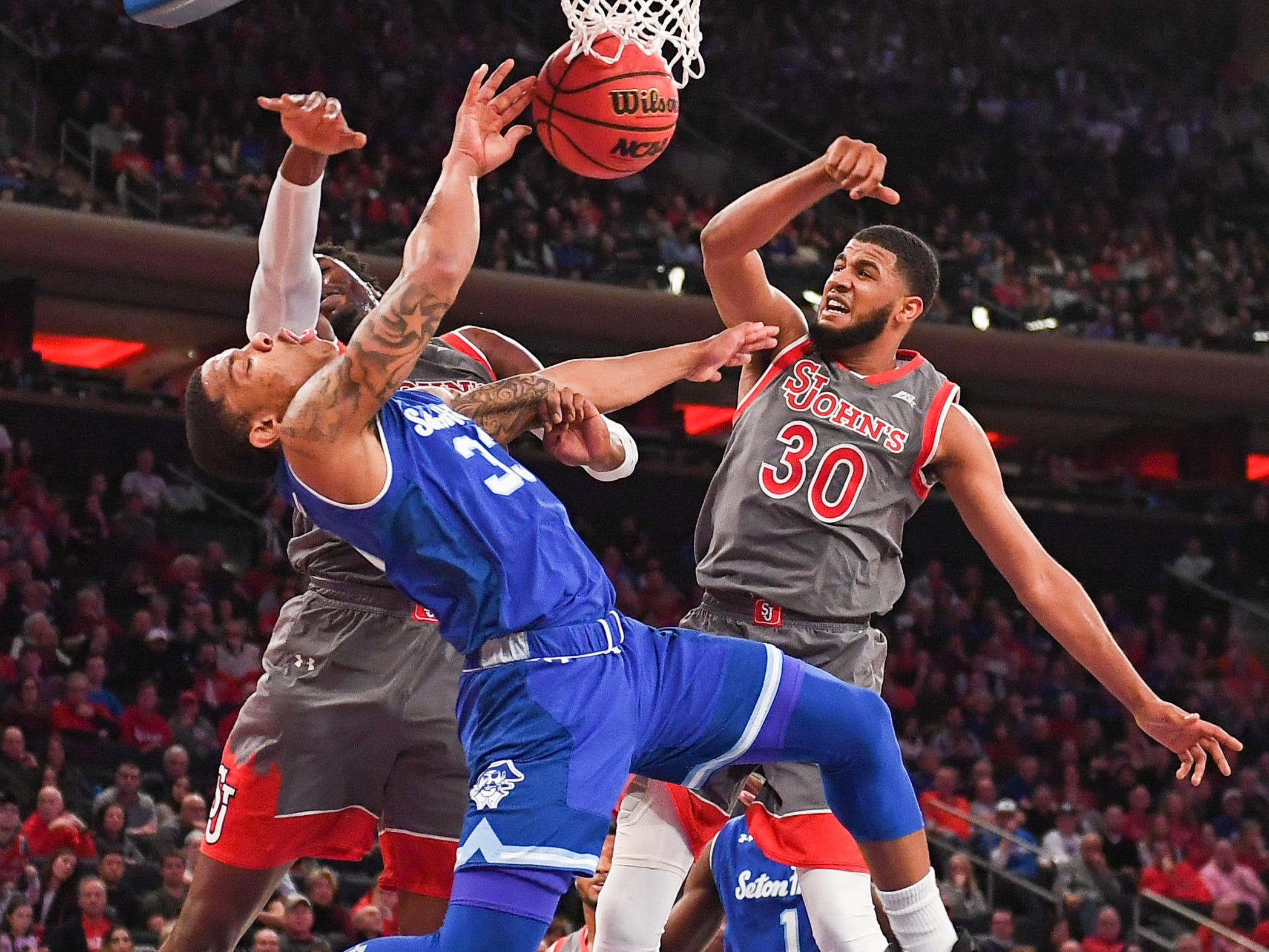 Feb. 23: Seton Hall guard Shavar Reynolds (33) loses the ball on a first-half drive to the bucket between a pair of St. John's defenders at Medison Square Garden.