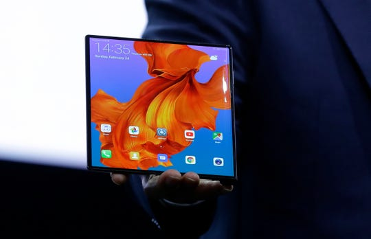 Huawei CEO Richard Yu displays the new Huawei Mate X foldable 5G smartphone at the Mobile World Congress, in Barcelona, Spain, Sunday, Feb. 24, 2019. The fair started with press conferences on Sunday, before the doors open on Monday, Feb. 25, and runs until Feb. 28.