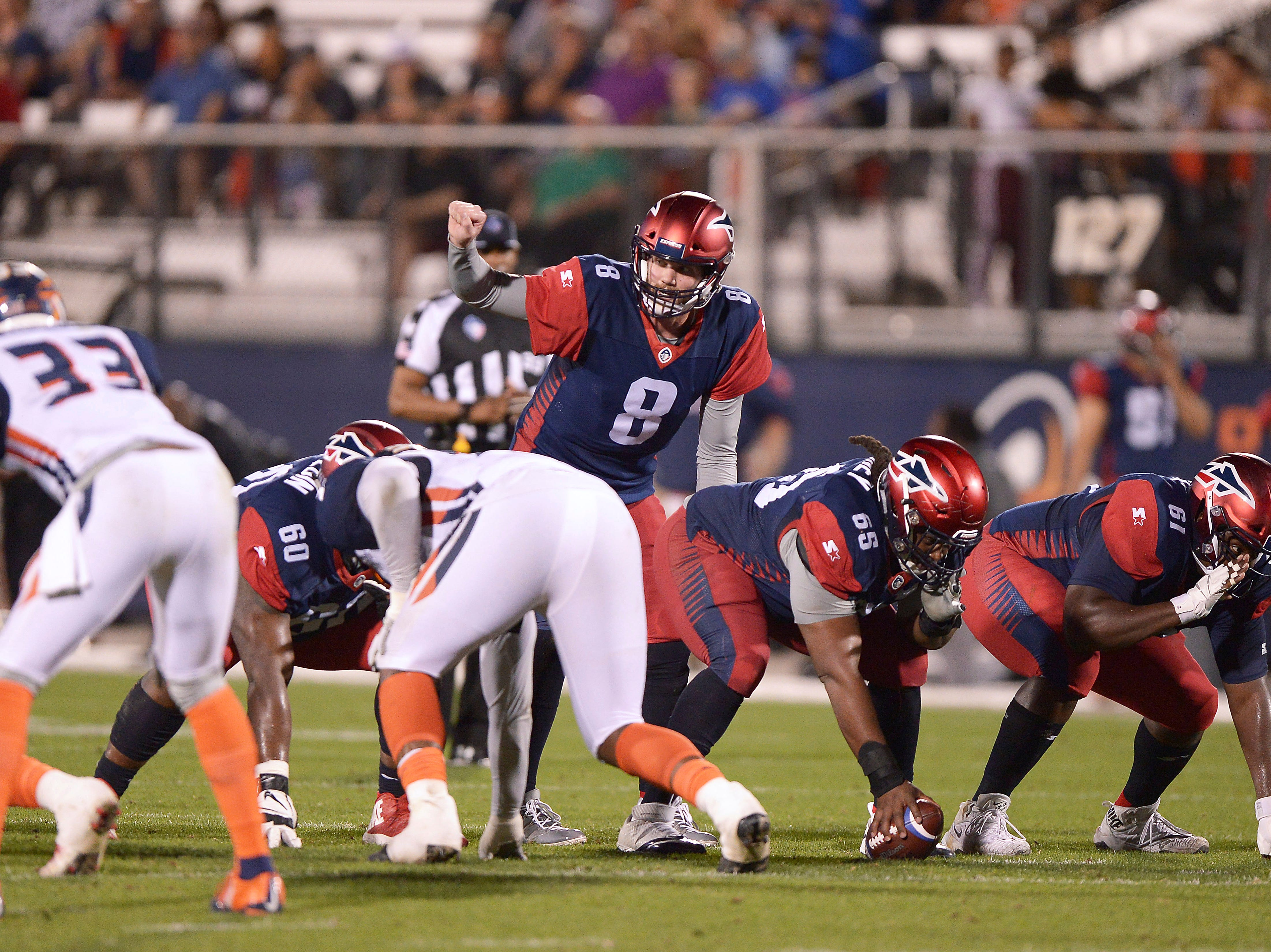 Memphis Express quarterback Zach Mettenberger (8) signals a receiver from under center against the Orlando Apollos during an AAF football game, Saturday, Feb. 23, 2019, at Spectrum Stadium in Orlando, Fla. (AP Photo/Rick Wilson) ORG XMIT: NYOTK
