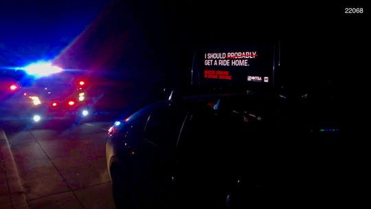 The California Highway Patrol arrests a man on suspicion of a DUI on Feb. 24, 2019 in Berkeley, California, while he drove a car with a sign warning against drunk driving.