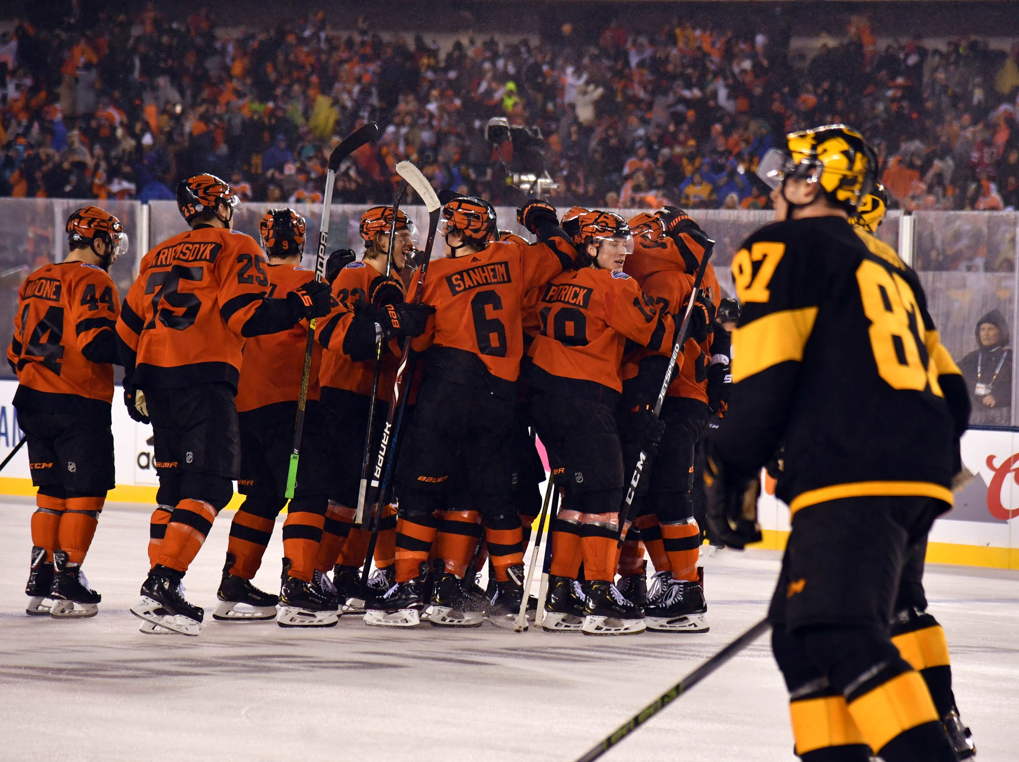Feb. 23: Pittsburgh Penguins center Sidney Crosbyskates by as the Philadelphia Flyers celebrate their 4-3 overtime win in an outdoor game at Lincoln Financial Field.