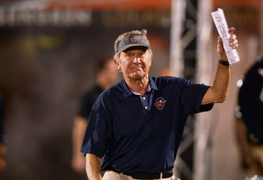 Orlando Apollos head coach Steve Spurrier waves to the crowd as he enters the field before kickoff against the Memphis Express.